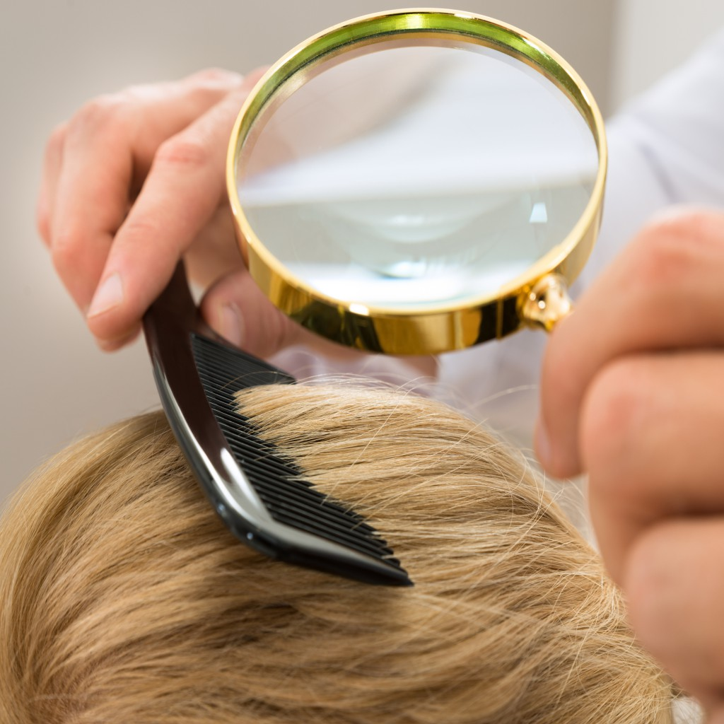 Magnifying-glass-and-hair-